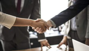 How To Plan My Future With 9 Tips Two people shaking hands in boardroom after a successful meeting
