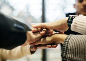 Hands of many friends one on top of the other declaring good close friendship