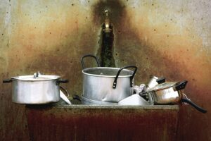 Home Cleaning Tips Tricks and Routines. Basin in the kitchen with dirty pots and pans