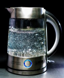 Home Cleaning Tips Tricks and Routines. Sparkling clean kettle boiling water.