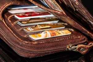 The Debt Trap Solved. A purse with string of credit cards.