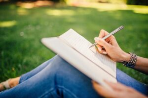 How To Plan My Future With 9 Tips Girl sitting in a quiet place and writing her goals