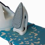 Cutlery Crockery Utensils and Food. Steam iron and ironing board
