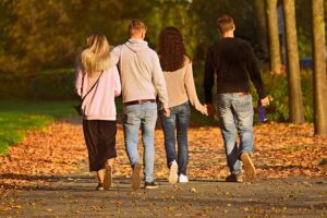 Two couples walking in the park., good friends.