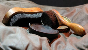 Romancing a Women. Cleaning shoes, Shoe polish, brushes and cloth.