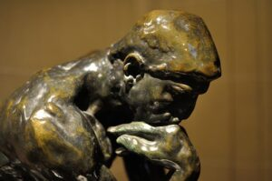 Making good life decisions. Statue of a man in deep thinking