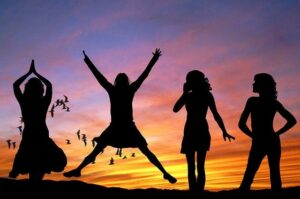 How To Be Happy Create Your Own Happiness. Happy girl with friends jumping high with  joy