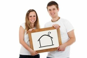 Tips for a Good Relationship Man and woman holding picture of home