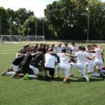 Emotional Intelligence for Good Leadership. A Sports Team in a circle getting motivated