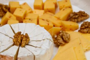 Picture of a wheel of cheese and walnuts
