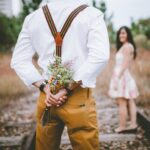 Romance.-man-with-wild-flowers-for-his-girl-nature-
