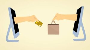 How To Build Customer Trust, Two-hands-through-a-PC-screen-making-a-sale-one-with-a-packet-and-one-with-a-credit-card-ecommerce