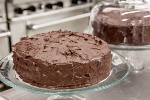 Tips Baking The best Box Cake, Chocolate cake with icing on a glass stand